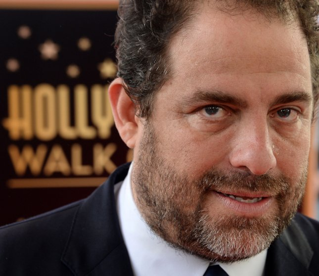 Director Brett Ratner speaks with reporters following an unveiling ceremony honoring him with the 2,599th star on the Hollywood Walk of Fame in Los Angeles on January 19. File Photo by Jim Ruymen/UPI