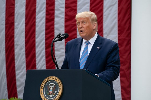 President Donald Trump introduces a plan Monday to ship 100 million rapid COVID-19 tests to states by the end of the year, encouraging governors to use them to help reopen schools. Photo by Ken Cedeno/UPI