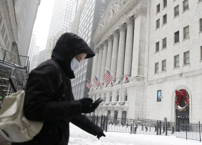 Wall Street closes out wild pandemic year with Dow, S&P at records