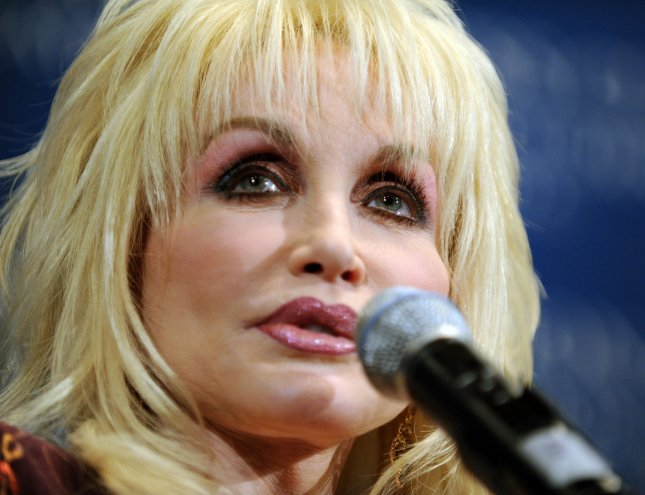 Dolly Parton, entertainer, singer and song writer, speaks to guests at the National Press Club in Washington on February 10, 2009. (UPI Photo/Roger L. Wollenberg)