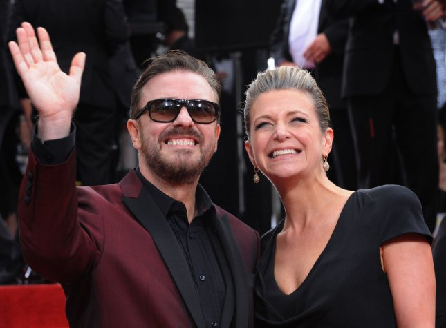 Host Ricky Gervais and producer Jane Fallon arrive at the 69th annual Golden Globe Awards in Beverly Hills, California on January 15, 2012. UPI/Jim Ruymen