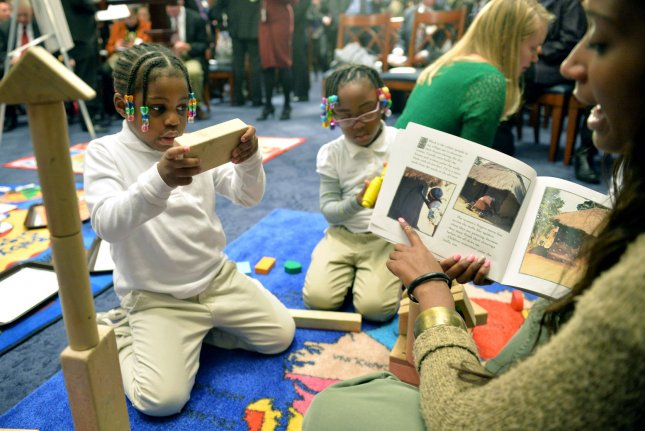 Students from AppleTree Learning Public Charter School play during an event in Washington, D.C. UPI/Kevin Dietsch
