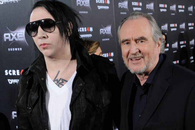 Musician Marilyn Manson (L) and director Wes Craven attend the premiere of the motion picture thriller Scream 4, at Grauman's Chinese Theatre in the Hollywood section of Los Angeles on April 11, 2011. UPI/Jim Ruymen