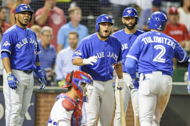 Toronto Blue Jays Troy Tulowitzki (2) is congratulated at the plate after hitting a three run home run in the top of the sixth inning against the Texas Rangers in game 3 of the ALDS at Rangers Ballpark in Arlington, Texas on October 11, 2015. Photo by Michael Prengler/UPI