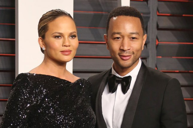 John Legend (R) and Chrissy Teigen at the Vanity Fair Oscar party on February 28. The couple welcomed daughter Luna in April. File Photo by David Silpa/UPI