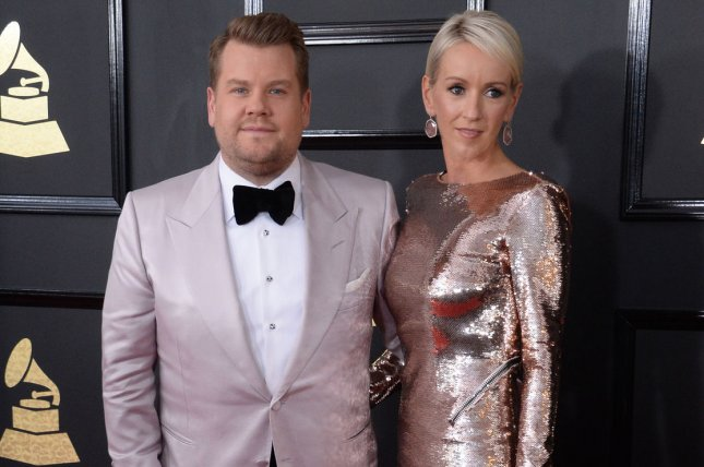 James Corden (L) and Julia Carey arrive for the 59th annual Grammy Awards on February 12. Corden poked fun at La La Land and the Oscars Monday on The Late Late Show. File Photo by Jim Ruymen/UPI