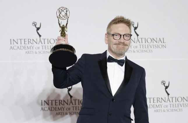 Kenneth Branagh holds the award for Best Performance by an Actor in Wallander at the 45th International Emmy Awards on Monday. Photo by John Angelillo/UPI