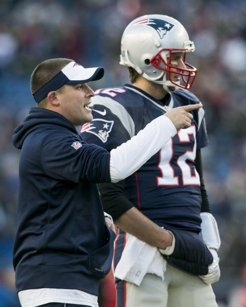 Former New England Patriots offensive coordinator Josh McDaniels and quarterback Tom Brady go through warmups before facing the Kansas City Chiefs in an AFC Divisional Playoff game on Jan. 16. Photo by Kelvin Ma/ UPI
