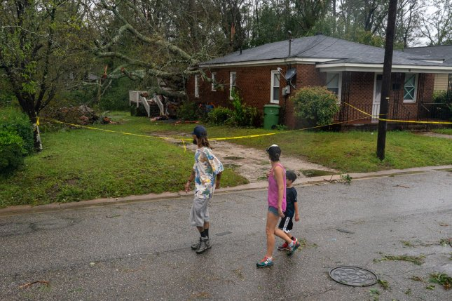 Local residents walk by the house where a large tree fell and trapped a family killing the mother and 8 month old baby during Hurricane, now tropical storm Florence on September 15, 2018 in Wilmington, North Carolina. Photo by Ken Cedeno/UPI