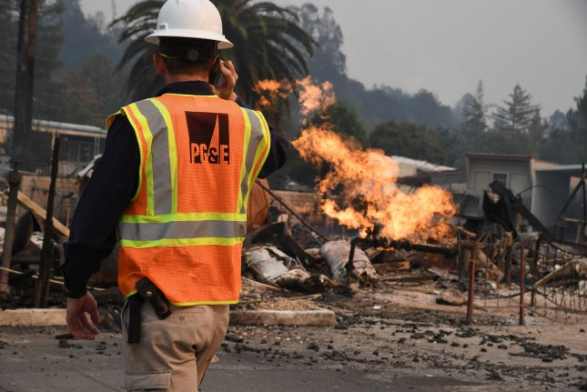 A Pacific Gas and Electric worker reported a burning gas main as wildfires fueled by wind and low humidity devastated Santa Rosa, Calif., on October 9, 2017. File Photo by Terry Schmitt/UPI