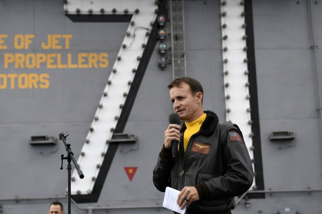 Top Navy officials have recommended that Brett Crozier, seen during an all-hands call on the flight deck of the USS Theodore Roosevelt in November 2019, be reinstated to his role as captain of the aircraft carrier. Photo by Nicholas Huynh/U.S. Navy