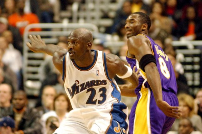 NBA icon Michael Jordan (23), who spoke at Los Angeles Lakers great Kobe Bryant's (8) memorial service last year, also will introduce Baylor women's basketball coach Kim Mulkey. File Photo by Roger L. Wollenberg/UPI