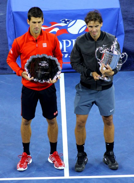Novak Djokovic (L) and Rafael Nadal are shown with their trophies after Nadal beat Djokovic in the finals of the 2013 U.S. Open. They are the top two ranked players going into next week's Australian Open, the first major tennis tournament of 2014. UPI /Monika Graff