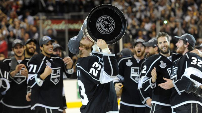 04c32c32af9 Los Angeles Kings right wing Dustin Brown (23) celebrates with the Cup at  the end of game 6 of the NHL Stanley Cup Finals against the New Jersey  Devils at ...