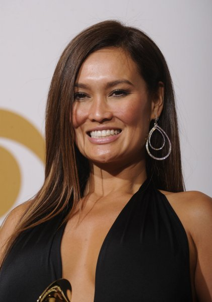 Tia Carrere holds her Grammy Award for Hawaiian Music Album won for Ikena at the 51st annual Grammy Awards at the Staples Center in Los Angeles on February 8, 2009. (UPI Photo/ Phil McCarten)