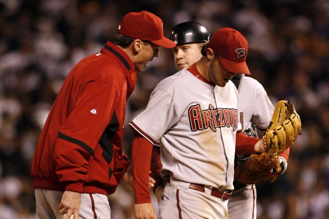 Arizona Diamondbacks manager Bob Melvin (L) relieves starting pitcher Micah Owings in the fourth inning against the Colorado Rockies during game four of the National League Championship Series at Coors Field in Denver on October 14, 2007. Colorado leads the series 3-0 over Arizona. Diamondbacks catcher Chris Snyder stands on the mound with Melvin. (UPI Photo/Gary C. Caskey)