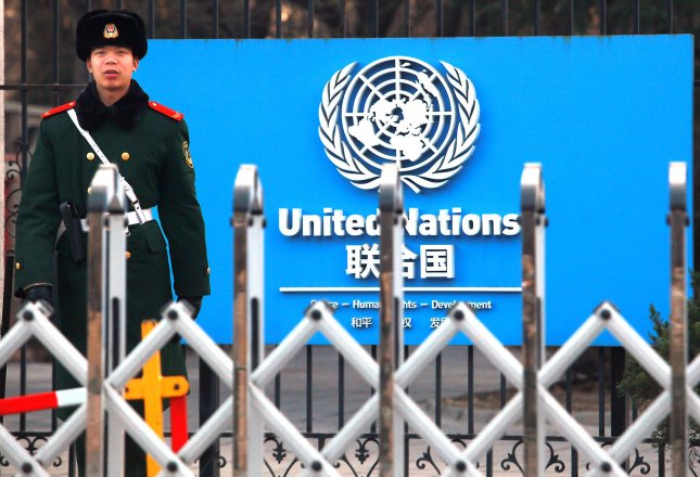 A soldier stands guard in front of the United Nations Embassy in Beijing, Jan. 3, 2014. The People's Republic of China, one of five permanent members of the Security Council (with the United States, United Kingdom, Russia and France) was admitted to the U.N. on Oct. 25, 1971, replacing Nationalist China. UPI/Stephen Shaver