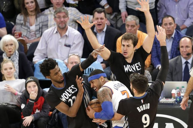 Minnesota Timberwolves Karl Anthony-Towns and Ricky Rubio surround New York Knicks Carmelo Anthony to give an intentional foul with a few seconds left in the game at Madison Square Garden in New York City on December 2, 2016. Photo by John Angelillo/UPI