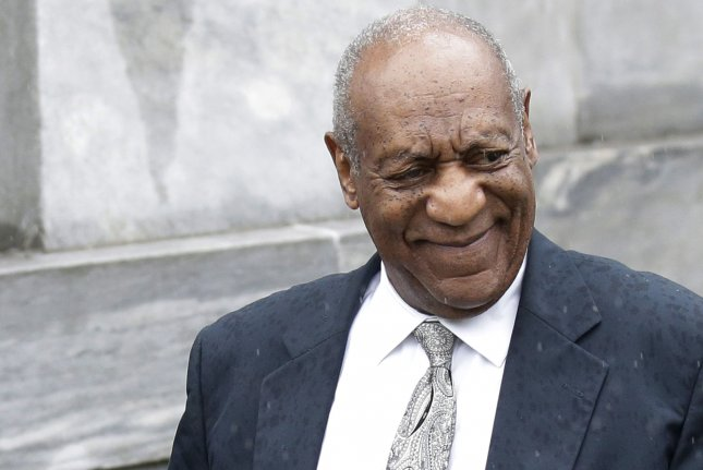 Cosby makes first look since mistrial