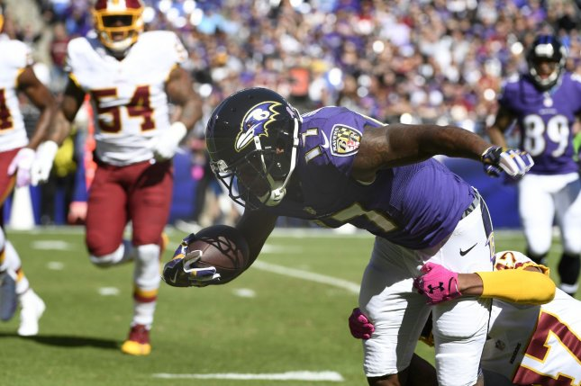 Baltimore Ravens wide receiver Mike Wallace tries to extend after his catch as Washington Redskins cornerback Quinton Dunbar tackles him in the first quarter on October 9, 2016 at M&T Bank Stadium, Baltimore, Maryland. File photo by Mike Theiler/UPI
