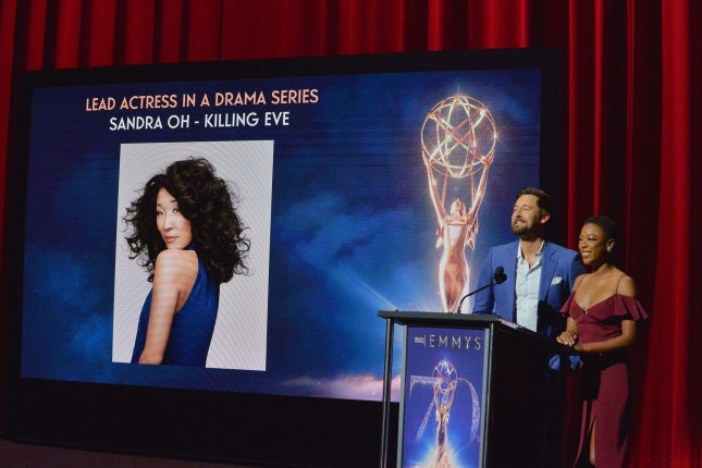 Actors Ryan Eggold (L) and Samira Wiley announce Sandra Oh's nomination for her role in Killing Eve for the Primetime Emmy Awards at the Television Academy's Wolf Theatre in North Hollywood, Calif., on Thursday. Photo by Jim Ruymen/UPI