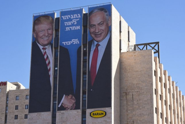 A large election advertisement featuring U.S. President Donald Trump and Israeli Prime Minister Benjamin Netanyahu is seen at the entrance to Jerusalem on February 4. File Photo by Debbie Hill/UPI