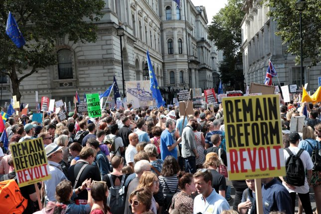 Anti-Brexit protesters gather outside No. 10 Downing St. Saturday in opposition to British Prime Minister Boris Johnson's decision to shut down Parliament. Photo by Hugo Philpott/UPI