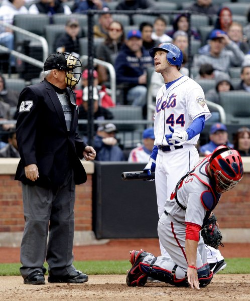 New York Mets starting pitcher Jason Bay argues with home plate umpire Larry Vanover after striking out in the sixth inning against the Washington Nationals at Citi Field in New York City on April 11, 2012. UPI/John Angelillo