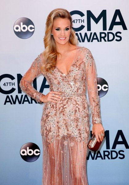 Carrie Underwood arrives on the red carpet at the 47th Annual Country Music Awards at the Bridgestone Arena in Nashville, November 6, 2013. UPI/Terry Wyatt