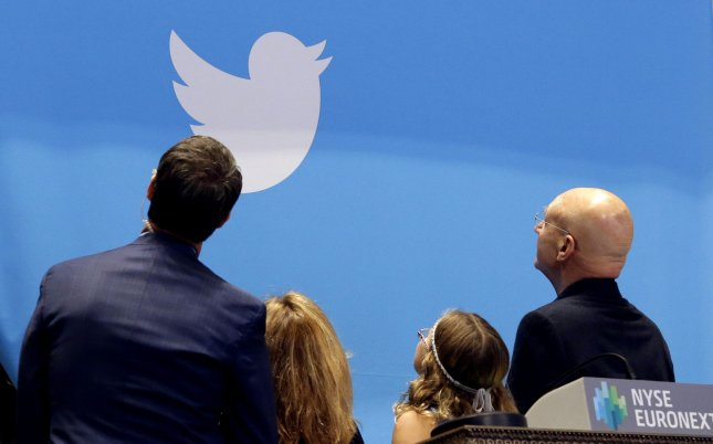 Guests of Twitter look at a camera before ringing the opening bell while waiting for shares of Twitter to be traded for the first time at the Twitter IPO on the floor of the New York Stock Exchange on Wall Street In New York City on Nov. 7, 2013. Requests by British authorities for Twitter users' personal information have doubled in 2015, but the United States still makes the most requests. File Photo by UPI/John Angelillo