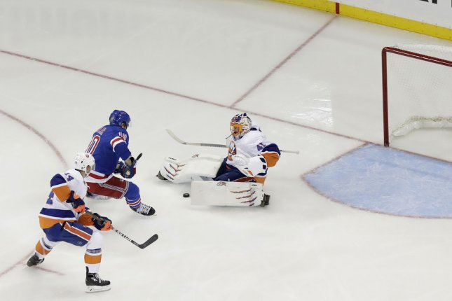 Persistence was the theme for the New York Islanders on Thursday night as they continued their recent success over the New York Rangers with a 4-2 victory. File Photo by John Angelillo/UPI