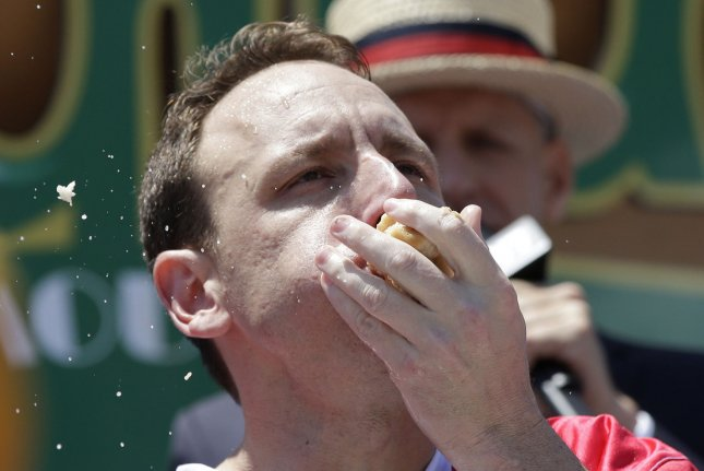 Chowing down hot dogs for Nathan's Famous Hot Dog Eating Contest