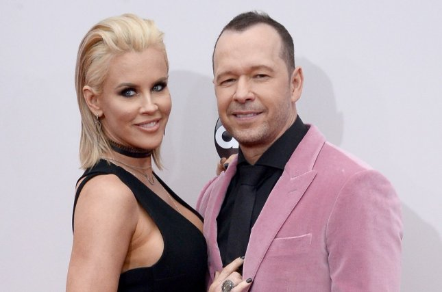 Jenny McCarthy (L) and Donnie Wahlberg attend the American Music Awards on November 20, 2016. McCarthy helped raise $10,000 for charity in Wahlberg's name for his 48th birthday. File Photo by Jim Ruymen/UPI