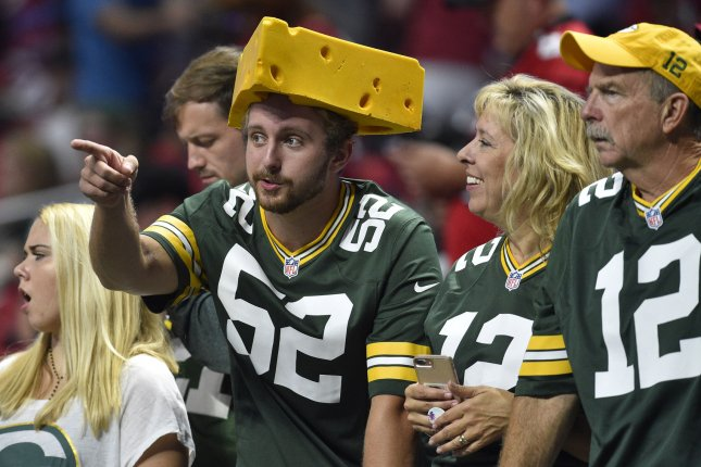 Green Bay Packers fans watch warmups before the Atlanta Falcons season home opener football game at the new retractable roof Mercedes Benz Dome on September 17 in Atlanta. Photo by David Tulis/UPI