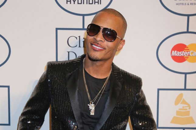 T.I. arrives on the red carpet before the annual Clive Davis Pre-Grammy Gala in Beverly Hills, Calif., on January 25, 2014. The rapper turns 40 on September 25. File Photo by David Silpa/UPI