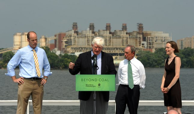 Michael Brune, executive director of the Sierra Club, Rep. Jim Moran, D-VA, then New York City Mayor Michael Bloomberg and Mary Anne Hitt, director of the Beyond Coal Campaign, (L to R) hold a news conference announcing a partnership between Bloomberg Philanthropies and the Sierra Club to push for shutting down coal-fired powerplants and replace them with more environmentally friendly options aboard the Nina Dandy across from the GenOn coal-fired powerplant in Alexandria, Virginia, on July 21, 2011. UPI/Roger L. Wollenberg