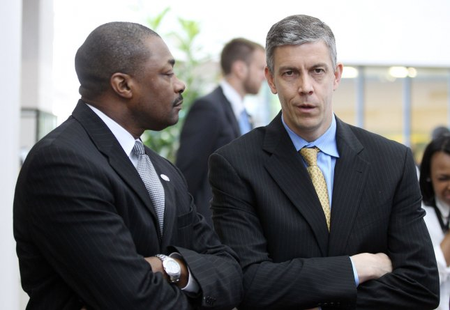 U.S. Secretary of Education Arne Duncan (R) talks with St. Louis Schools Superintendent Dr. Kelvin Adams before an earthquake drill at the Carnahan High School of the Future in St. Louis on April 28, 2011 UPI/Bill Greenblatt
