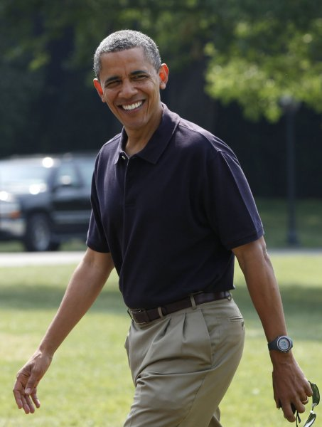 U.S. President Barack Obama smiles as he walks on the South Lawn of the White House upon his return to Washington from Camp David on July 8, 2012. UPI/Yuri Gripas