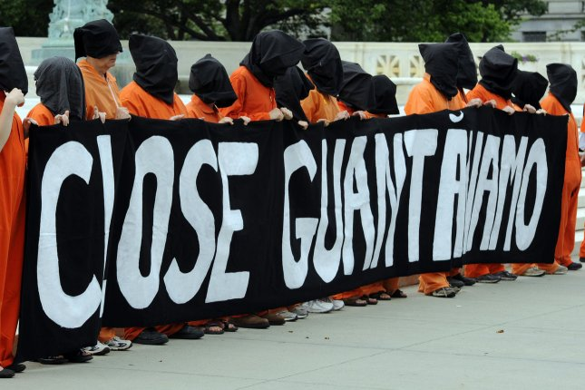 Demonstrators from Amnesty International and Witness Against Torture hold a procession against the use of torture and continued detentions in Guantanamo Bay, Cuba, outside the Supreme Court in Washington, DC, on June 23, 2011. (UPI/Roger L. Wollenberg)