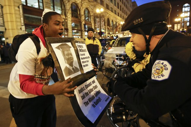 A protest similar to the one seen here on Nov. 25 shut down much of Chicago's famed Magnificent Mile shopping district on Black Friday. Demonstrators are calling for a federal investigation in the 2014 police shooting of Laquan McDonald. The 17-year old, who was armed with a small knife while fleeing police, was shot 16 times by officer Jason Van Dyke on the night of October 20, 2014. The Chicago Police, in response to a judge's order, released the dash cam video on Nov. 24, the same day that Van Dyke was charged with first-degree murder and fired from the police force. Photo by Kamil Krzaczynski/UPI