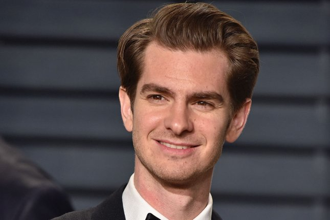 Andrew Garfield attends the Vanity Fair Oscar Party in Beverly Hills on February 26. Garfield was plucked out of the audience at a London drag show and gamely lip synced to Whitney Houston's I'm Every Woman this week. File Photo by Christine Chew/UPI