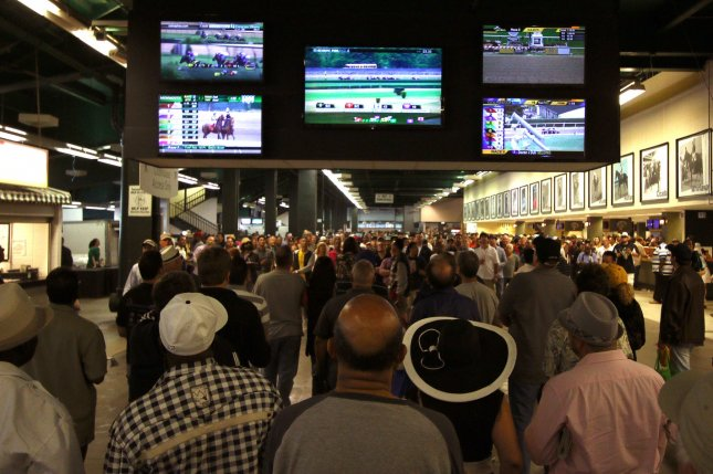 Bettors watch horse races at Belmont Park in Elmont, N.Y. Monday, the U.S. Supreme Court struck down a federal law that prohibited sports gambling nationwide. File Photo by Mark Abraham/UPI