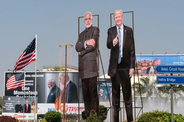 Large cardboard cut-outs of U.S. President Donald Trump and Indian Prime Minister Narendra Modi are seen in Ahmedabad, India, on Monday at the start of a 36-hour visit by the American leader. Photo by Andrea Hanks/the White House/UPI