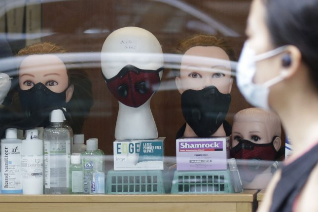 Researchers say that double-masking -- combining a medical mask and cloth mask -- can better protect against spread of the coronavirus. File Photo by John Angelillo/UPI