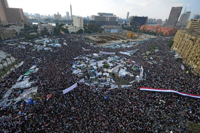 Egyptian anti-government protesters gather in Cairo's Tahrir square in Egypt on February 8, 2011 as they display their national flag on the 15th day of protests against the regime of President Hosni Mubarak. UPI