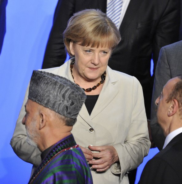 German Chancellor Angela Merkel (C) at International Security Assistance Force meeting on Afghanistan May 21 and Afghan President Hamid Karzai (R). UPI/Brian Kersey