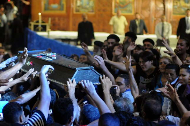 Egyptian Coptic men carry the coffin of a victim of deadly clashes, during a funeral at Abassaiya Cathedral in Cairo on October 10, 2011, a day after 24 people, mostly Christians, died in clashes with Egyptian security force. UPI/ Mohamad Hosam