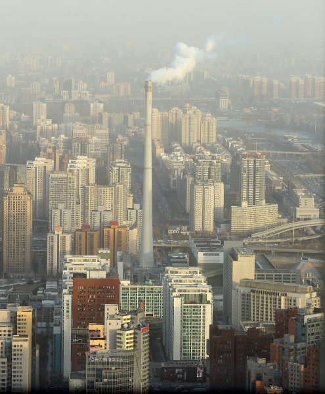 A dense smog hangs over central Beijing in December 2014. File Photo by Stephen Shaver/UPI