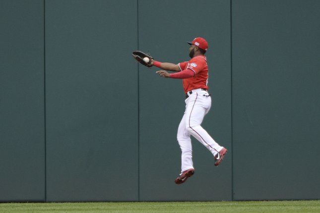 Denard Span catches a fly ball hit by San Francisco Giants' Gregor Blanco during the first inning of game 1 of the NL Division Series at Nationals Park on October 3, 2014. The Giants signed Span to a three-year, $31 million contract in the offseason. Photo by Pat Benic/UPI
