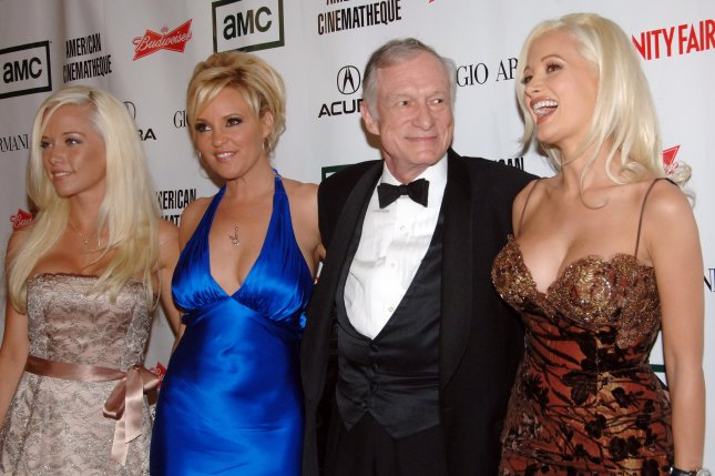Playboy magazine founder Hugh Hefner and his three live-in girlfriends (L-R) Kendra Wilkinson, Bridget Marquardt and Holly Madison arrive at the American Cinematheque annual benefit gala in Beverly Hills on October 13, 2006. File Photo by Jim Ruymen/UPI